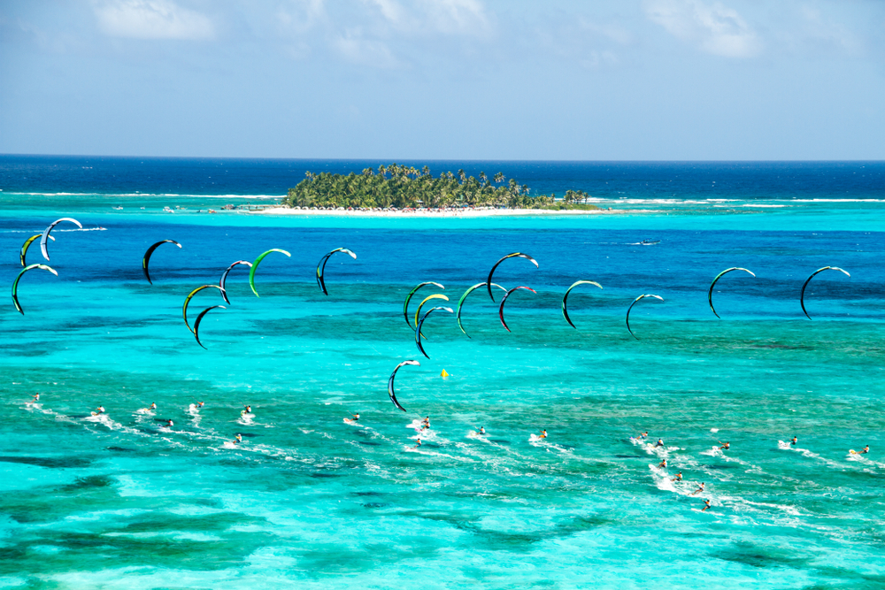 International kitesurfing competition taking place in the island of San Andres in the country of Colombia. The small island at the back is Johnny Cay