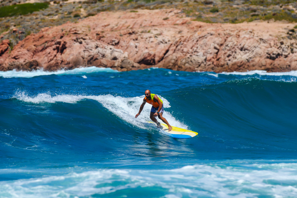 Sardinia Isola Rossa July 15 2017 Surfer in Sardinia during a mistral