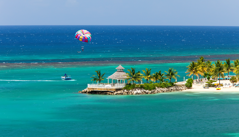 Para sailing over the tropical island of Ocho Rios, Jamaica.