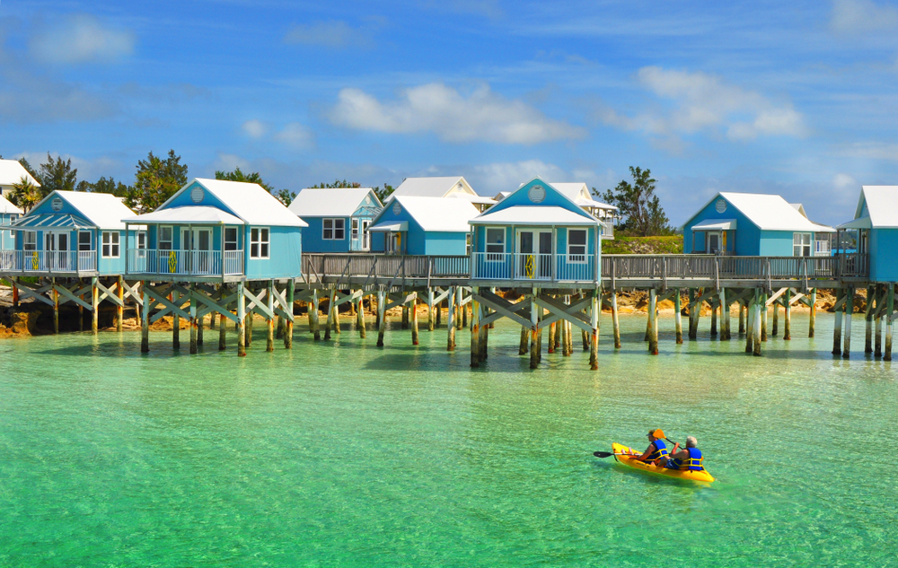 Beautiful tropical beach on Bermuda Island and houses on stilts
