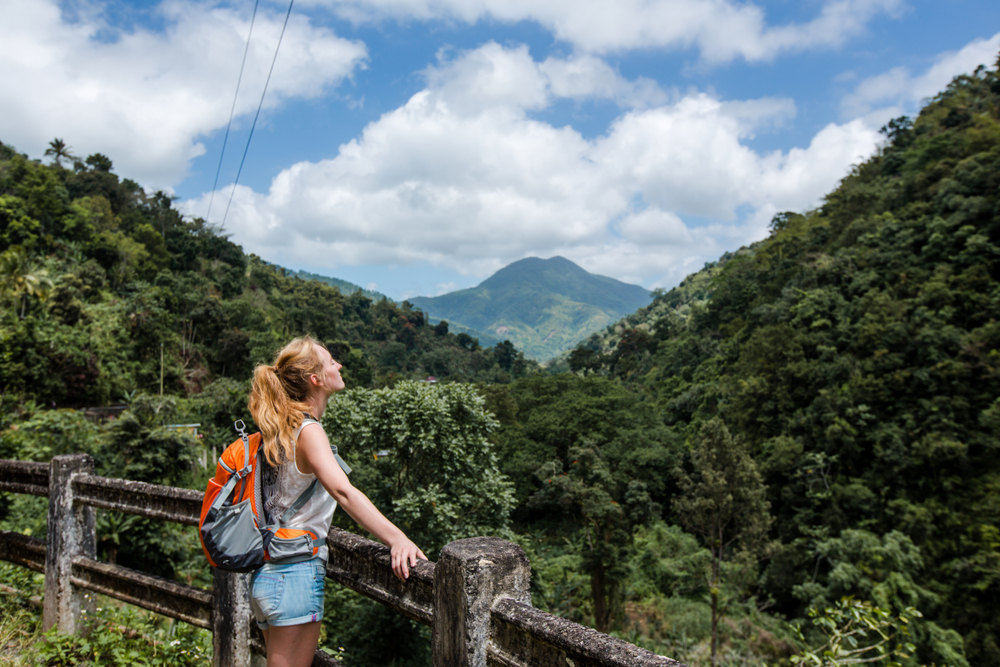 Young woman hiking in the mountains in Jamaica