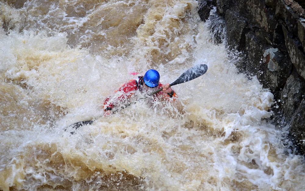 Whitewater kayaking in spring, Nurmijarvi Finland. It's so cold water!