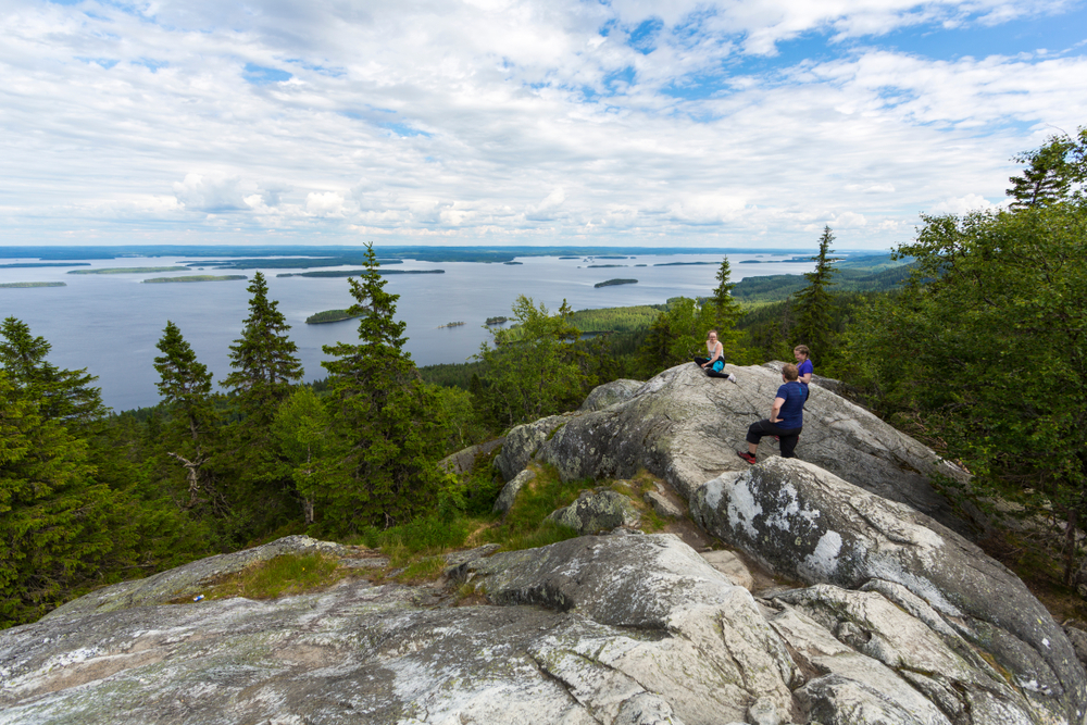 People seen on the rocks in Koli National Park in Finland in summertime.