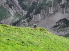 Young woman enjoying nature while hiking on Durmitor mountains, Montenegro
