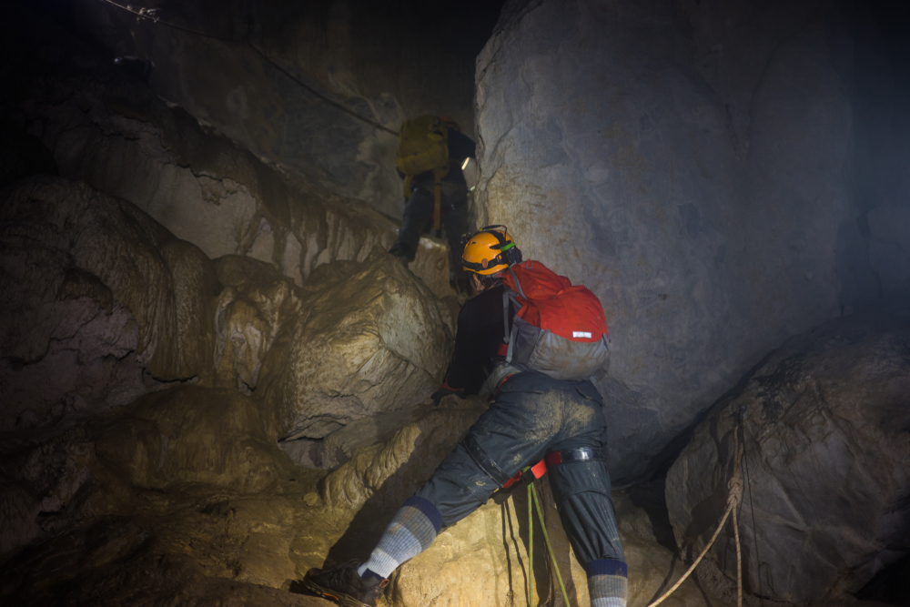 A man climbing rock by rope in Son Doong Cave, the largest cave in the world, is in the heart of the Phong Nha Ke Bang National Park in the Quang Binh province of Central Vietnam