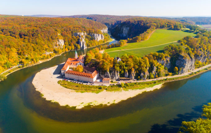 Aerial view to Weltenburg Abbey - Kloster Weltenburg. This landmark is a Benedictine monastery in Weltenburg in Kelheim on the Danube in Bavaria, Germany.