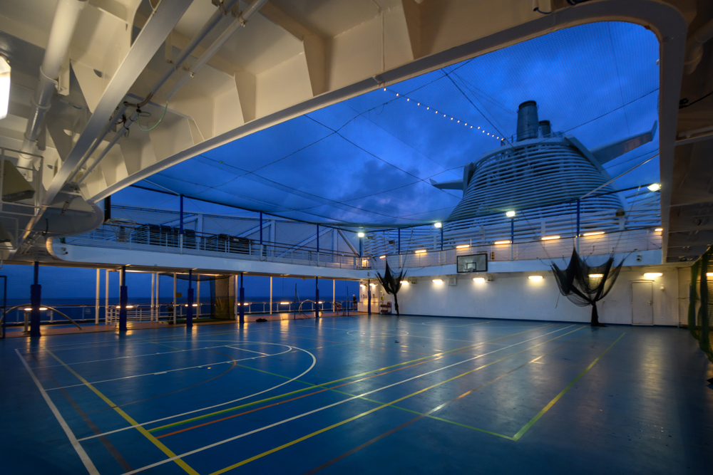 Area for playing sports on Board the cruise ship. Late evening. Lanterns, dark blue sky