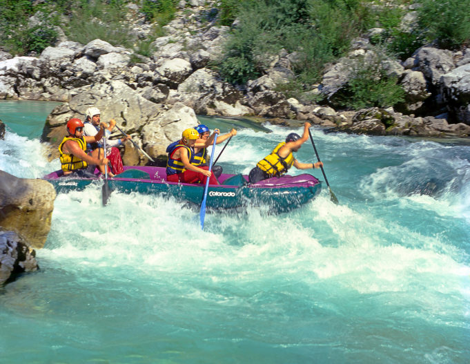 SOCA RIVER, SLOVENIA - JULY 8: White water rafting on the rapids of river Soca on July 8, 1998 in Triglav national park, Slovenia. Soca is one of the most beautiful rivers of Europe.