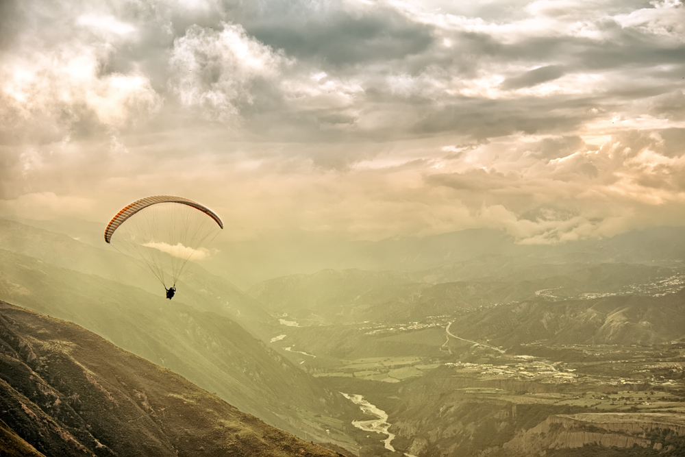 Paragliding in Andes at the sunset