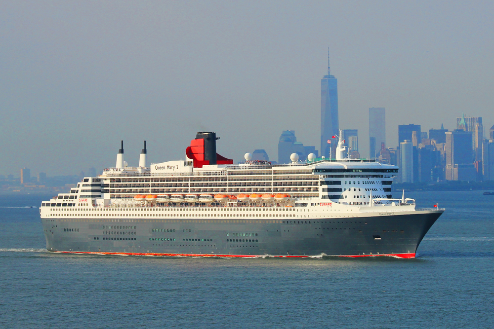 NEW YORK CITY - JULY 1: Queen Mary 2 cruise ship in New York Harbor heading for Canada and New England on July 1, 2014