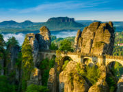 Bridge named Bastei in Saxon Switzerland, at sunrise and the mist over the river Elbe, National park Saxon Switzerland
