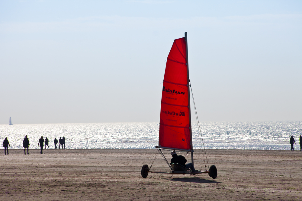 IJMUIDEN, THE NETHERLANDS -MARCH 20TH 2011: Beach sailing cart (Blokart) with red sail on the beach in IJmuiden on March 20th 2011