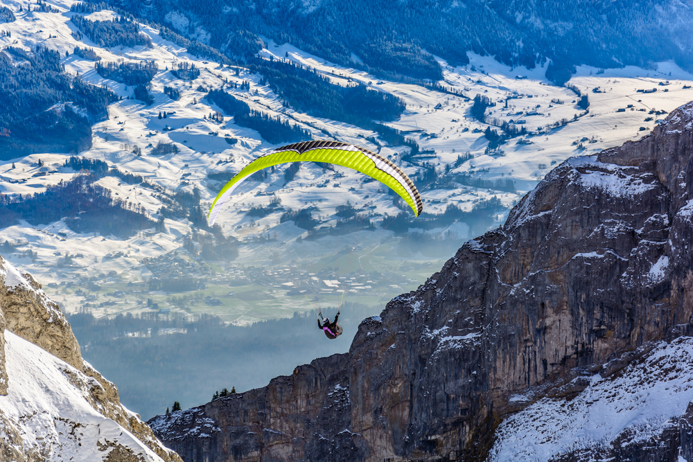 Paraglider! Switzerland Alp mountains in the background
