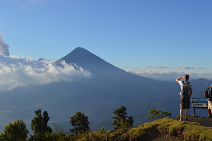 View of Volcan Agua near Antigua, Guatemala. Blue sky with some passing cloud