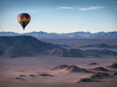Colorful hot-air balloon flying over the high mountains in Namibia. High altitude. ( Namibia, South Africa)