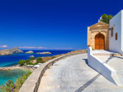 beautiful house in Lindos on the background of the bay, yachts and ships Rhodes Greece