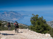 Sardinia on the paths between mountains and sea with the mountain bike, trail to Cala Luna on background the sea