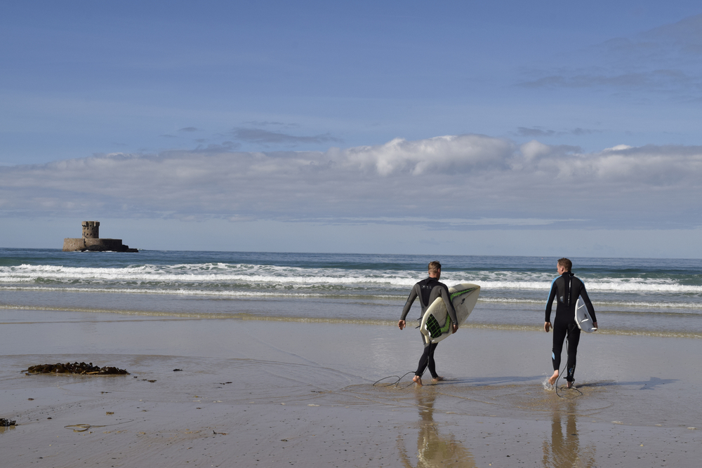 Two men going surfing in Jersey. Taken on 29th September 2016. For editorial use only.