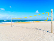 Volleyball net on sandy beach near Kampen village on Sylt island, North Sea, Germany