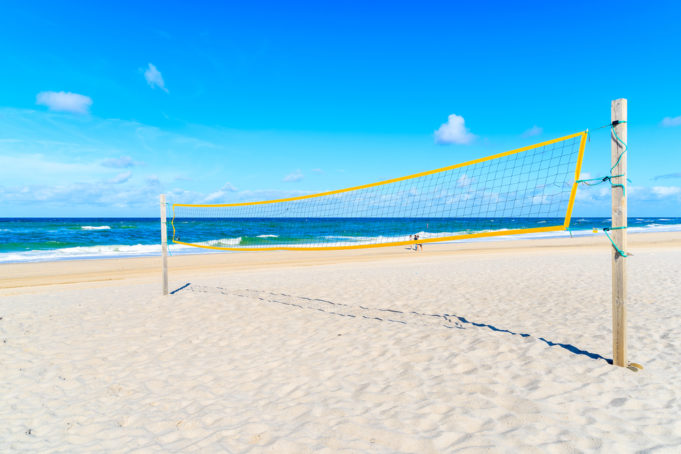 Volleyball net on sandy beach near Kampen village on Sylt island, North Sea, Germany