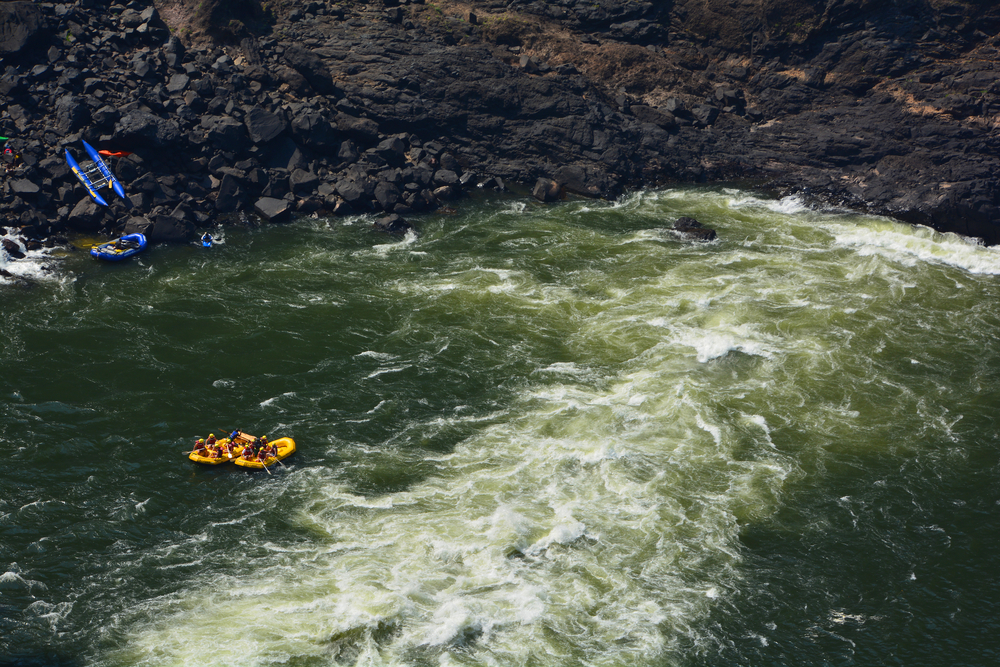 VICTORIA FALLS ZIMBABWE OCT 16 2014: Victoria Falls White Water Rafting names of rapids like Stairway to Heaven, The Terminator, The Washing Machine, Judgement Day, Devils Toilet Bowl and Oblivion