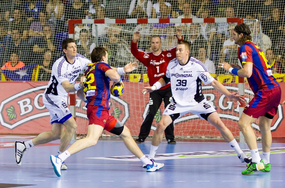 BARCELONA - APRIL 24: Siarhei Rutenka (22) shoot a goal during the handball Champions League match between Barcelona and THW Kiel on April 24, 2011 in Barcelona, Spain. Final score 27 - 25.