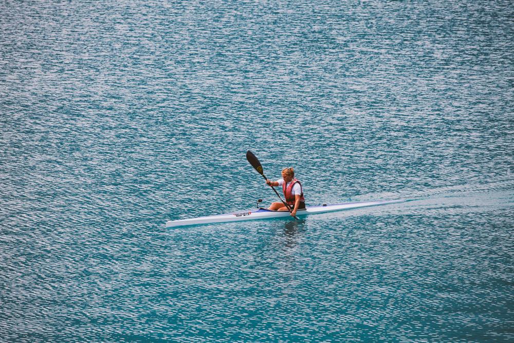 Italy Lake Lago di Ledro July 16, 2013. Female athlete engaged in kayak rowing.