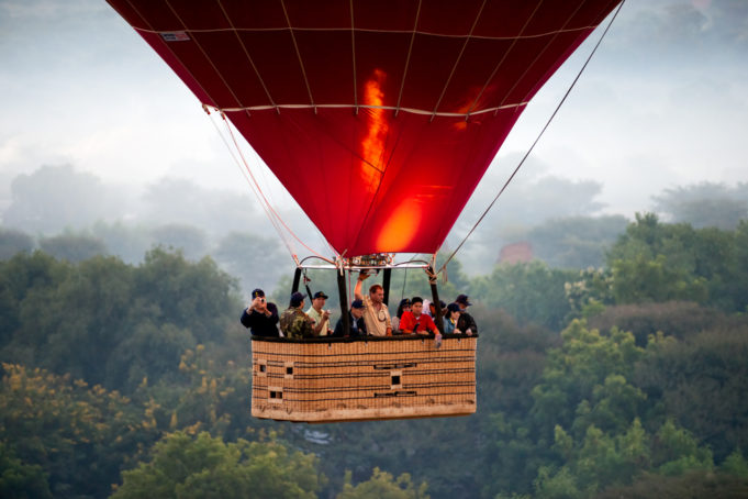 BAGAN - NOVEMBER 29,: Tourist in an Hot Air Balloon over the plain of Bagan, an ancient city in the Mandalay Region of Myanmar. November 29, 2008, in Bagan, Myanmar.